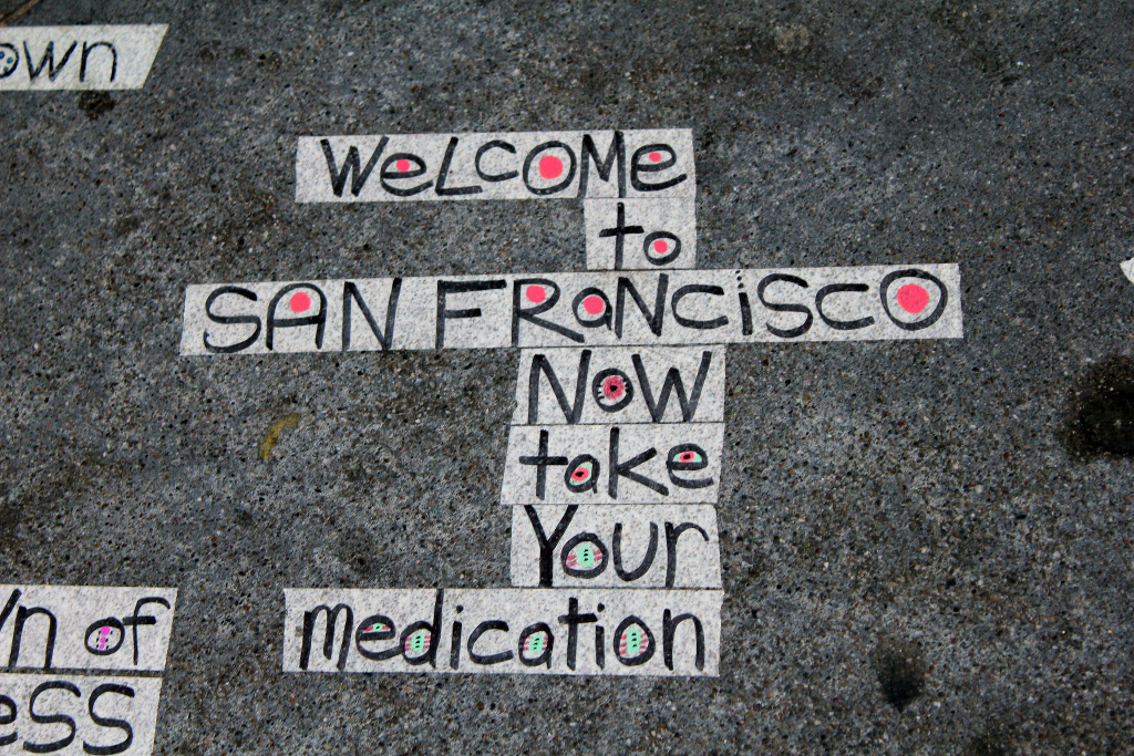 Street art saying: Welcome to San Francisco, now take your medication.