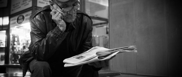 A person reading the newspaper.
