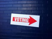 A sign pointing the way to a polling place.
