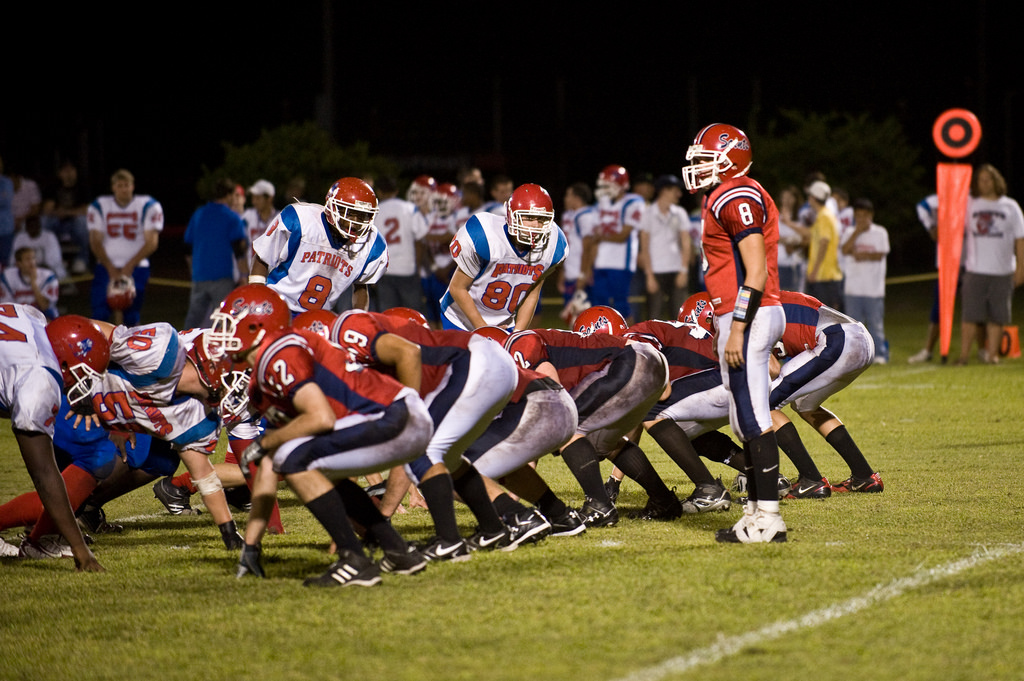 A high school football team on the field.