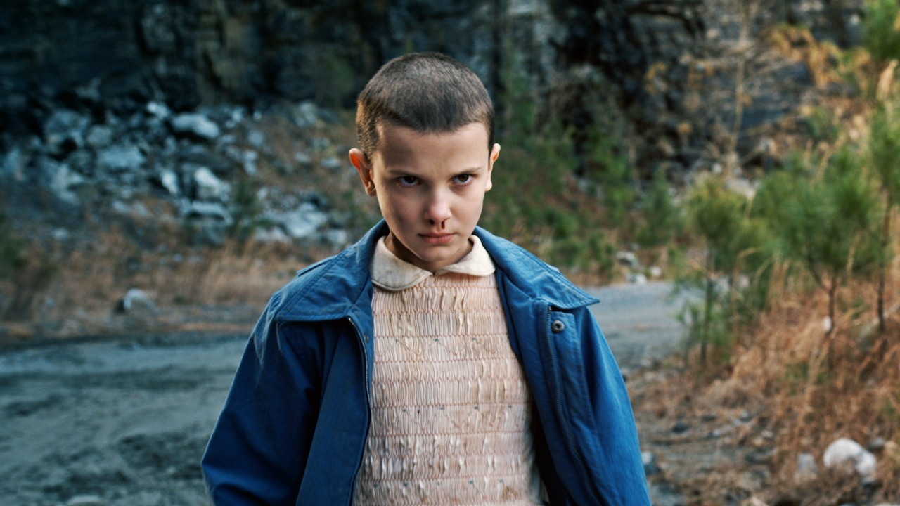 Eleven on Stranger Things, concentrating on someone offscreen.