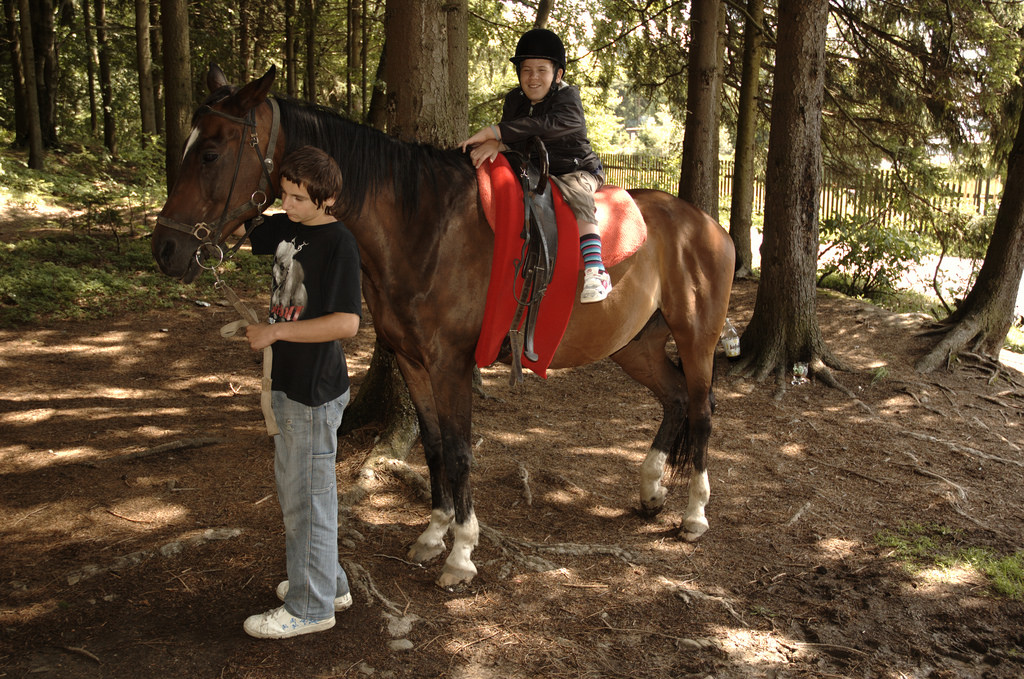 A disabled child riding a horse.