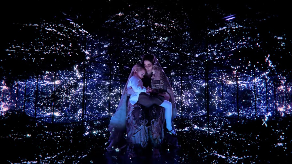 A screenshot from the OA, showing the titular character in the arms of an angel.