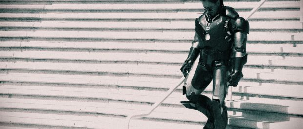 A cosplayer walks down a set of stairs.