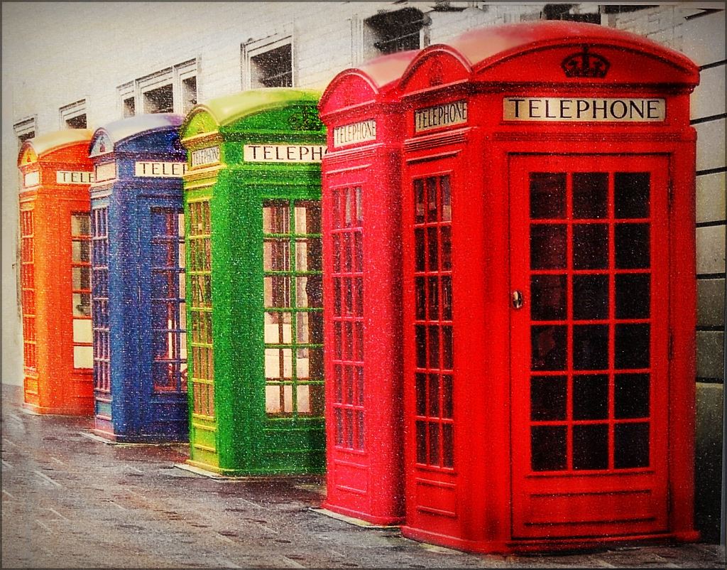A row of rainbow coloured phone booths.