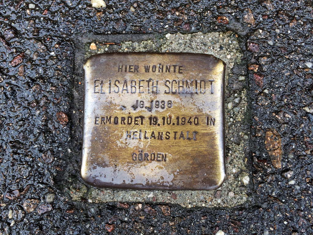 A brass plaque commemorating Elisabeth Schmidt, deported and murdered in the Nazi eugenics programme.