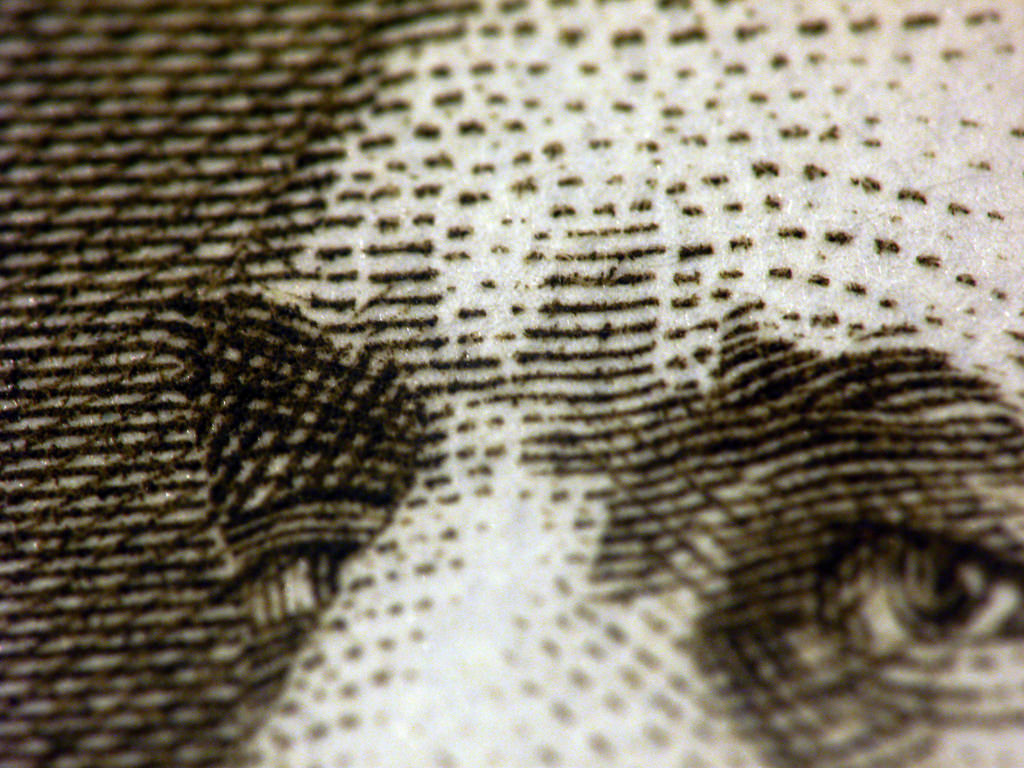 A closeup of the engraving on a piece of money.