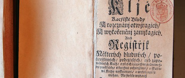 A very old manuscript, letterpressed, with dramatic gothic lettering.