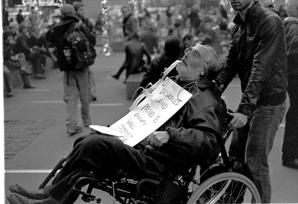 A protester using a ventilator and a wheelchair protesting at Zucotti Park during Occupy Wall Street.