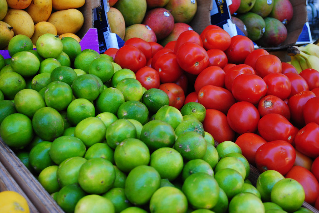 Tomatoes and limes at a market.