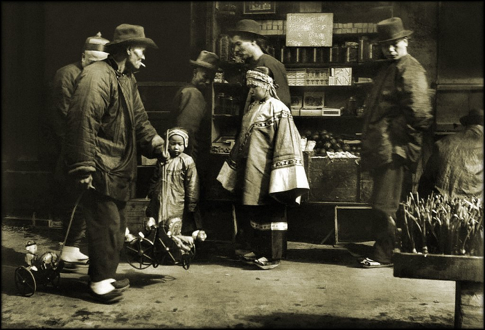 A toy vendor in early 20th century Chinatown.