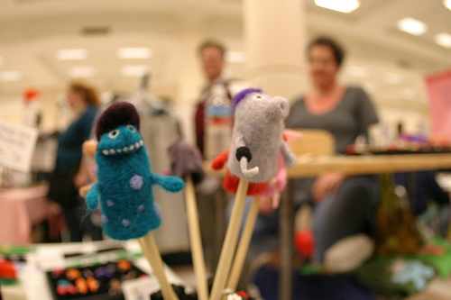 Two felted finger puppets, looking ready to take over the world.