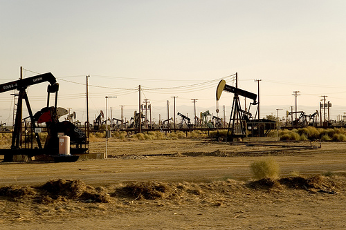 Oil wells in what looks like Southern California.
