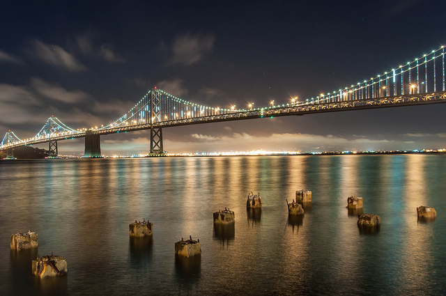 A shot of the West span of the Bay Bridge illuminated at night.