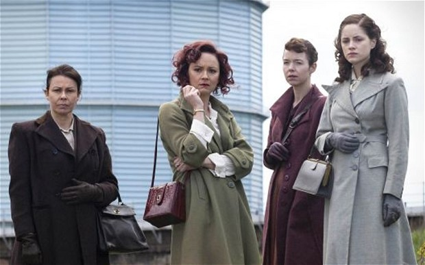 The four women of Bletchley Circle standing in front of a grain silo.