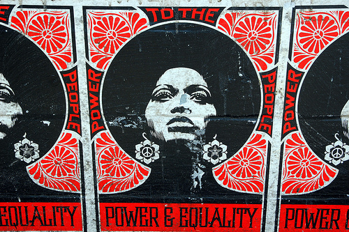 A row of Black power posters featuring a striking woman with an Afro, reading Power to the People, Power is Equality.