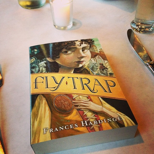 My copy of FLY TRAP on a dinner table.