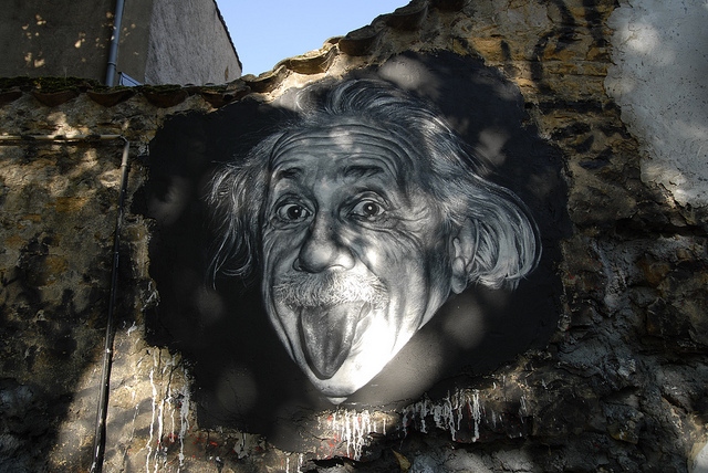 A painted portrait of the famous picture of Albert Einstein sticking his tongue out.