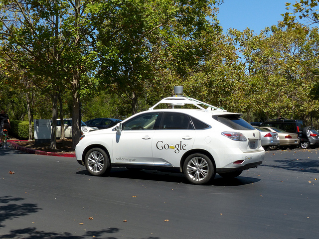 One of Google's self-driving vehicle prototypes maneuvering in a parking lot.