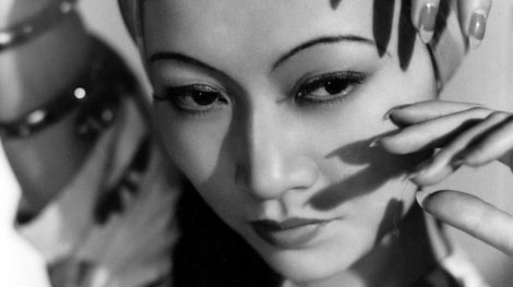 A black and white photograph of Chinese silent film star Anna May Wong.