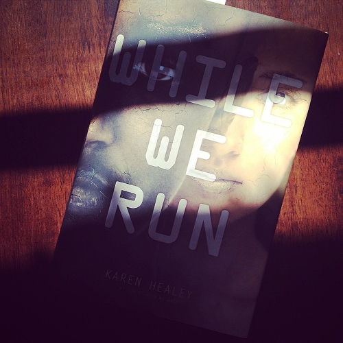 My copy of WHILE WE RUN lying on the kitchen table.
