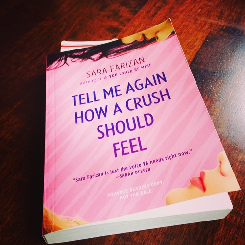 My copy of TELL ME AGAIN HOW A CRUSH SHOULD FEEL on the table.
