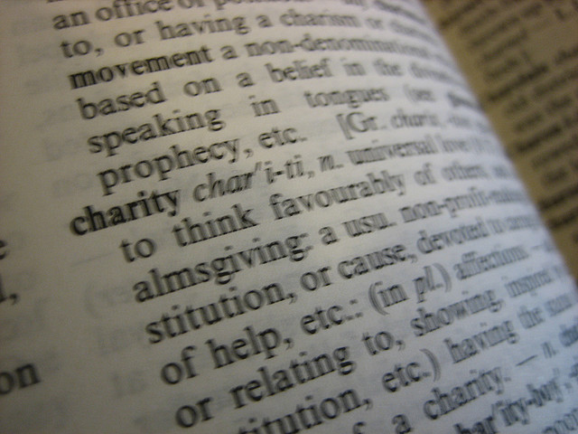 A dictionary opened to the definition of CHARITY