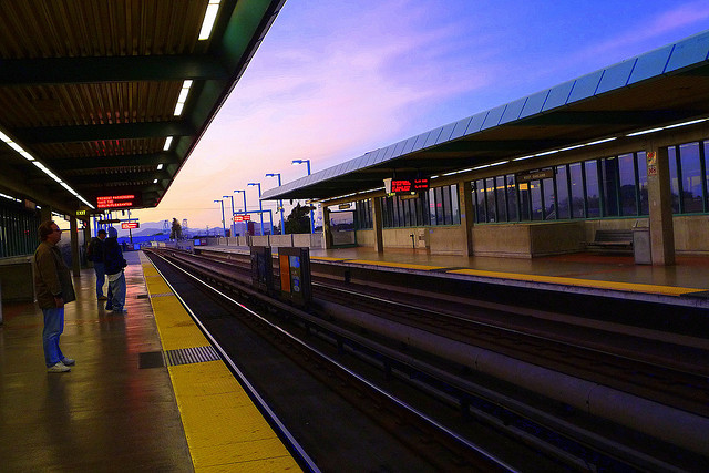 The West Oakland BART station at dusk.