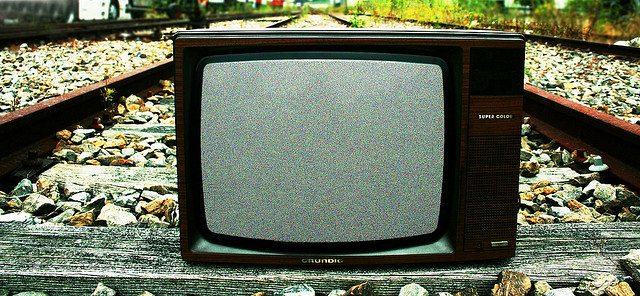 A television in the middle of train tracks