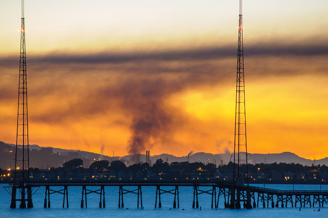 A plume rising from a major fire at a Chevron refinery in Richmond
