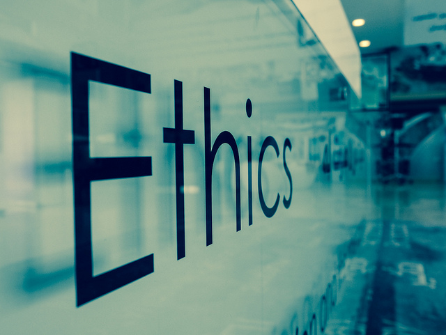 The word ETHICS printed across a wall