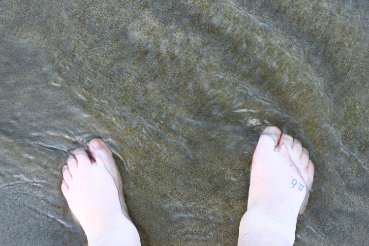 My feet in a stream