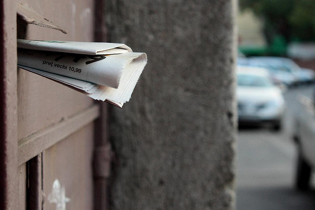 A mail slot with envelopes sticking out