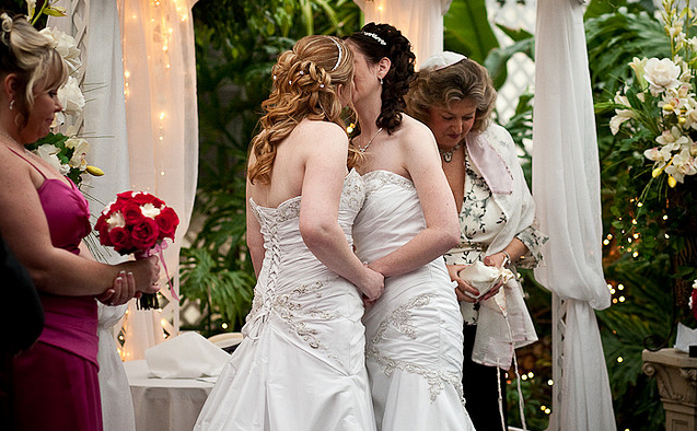 Two women kissing at the altar