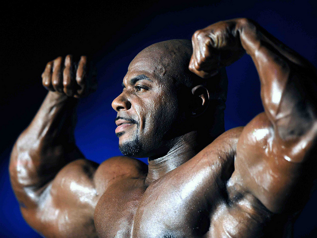 A bodybuilder posing in a competition