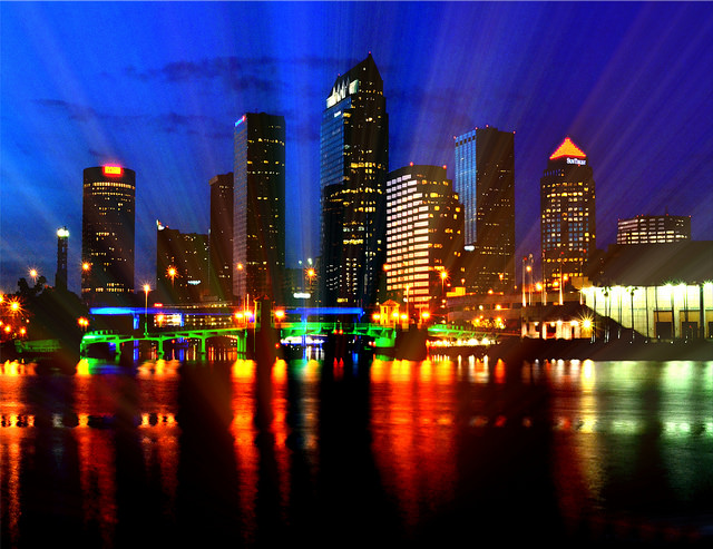 A hypersaturated image of a city at night