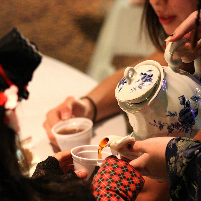 People pouring tea