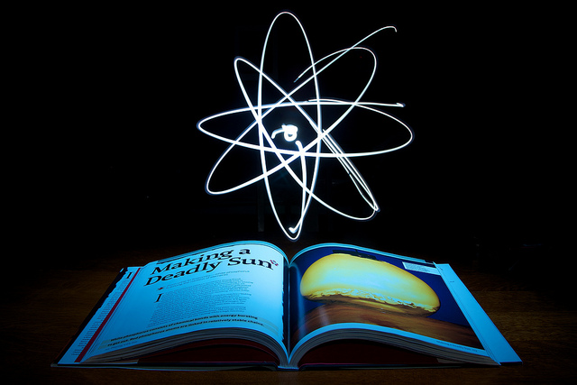 A symbol of the atom hovering above a science magazine