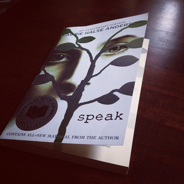 SPEAK's dramatic cover with a face behind a silver-leafed tree