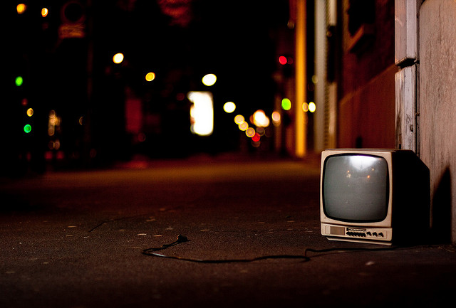 An abandoned television in the street