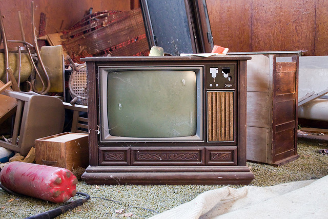 A vintage television on an antiques lot