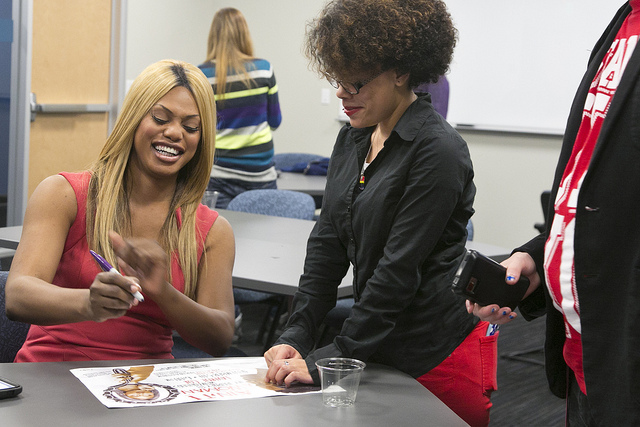 Actress Laverne Cox signing autographs.