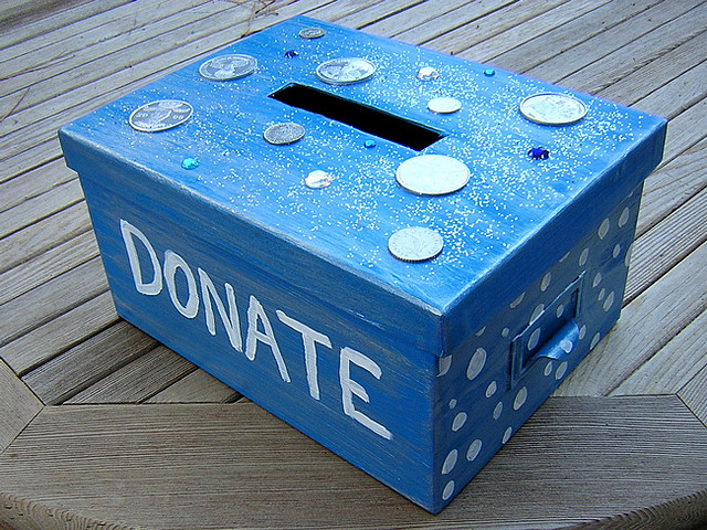 A blue and sparkly donation box for a charity event.