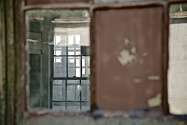 A fractured, off-kilter view of the inside of a building.