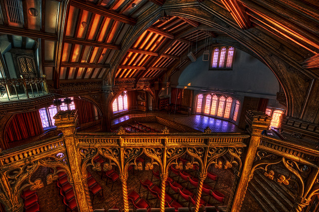 An empty theatre with highly baroque architecture.