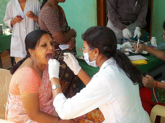 A dentist administering care to a patient.