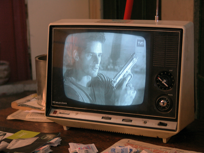 A television set showing a black and white film.