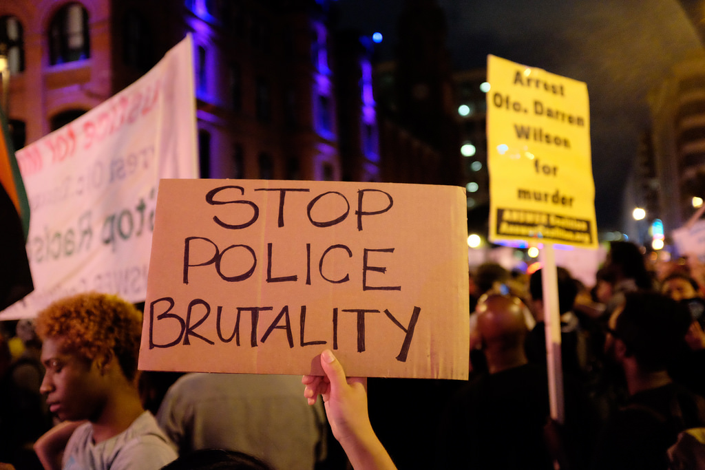 Protesters at a march demanding justice for victims of police brutality.