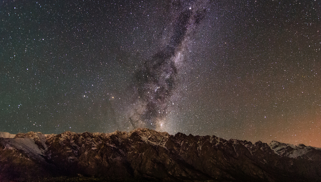 The Milky Way spanning the sky at night.