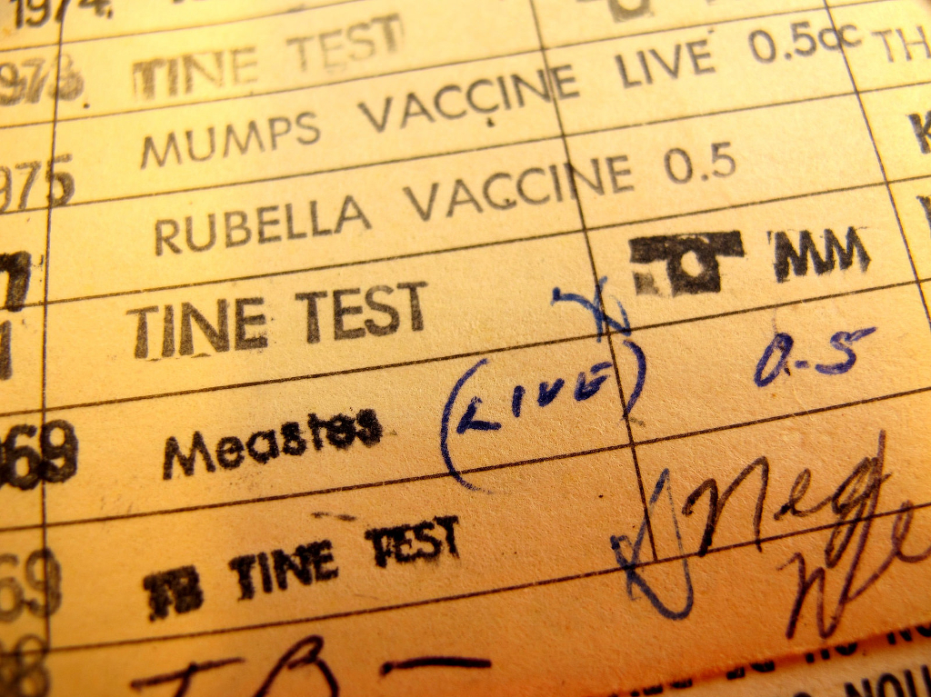A paper vaccination record from the middle of the 20th century.